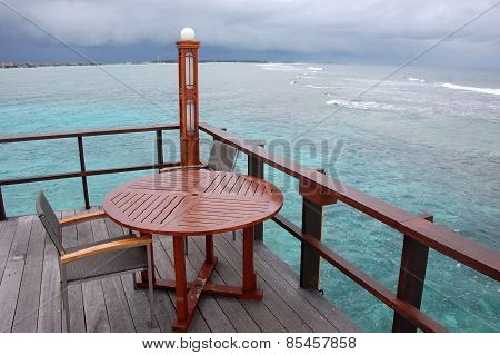 Table And Chair At Open Air Cafe With Ocean View