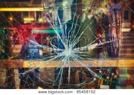 Broken shop window with color background