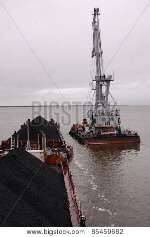 Cargo Crane At Platform Near Ship With Coal