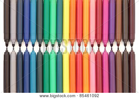 Large multi colioured felt tip pen selection over white background.