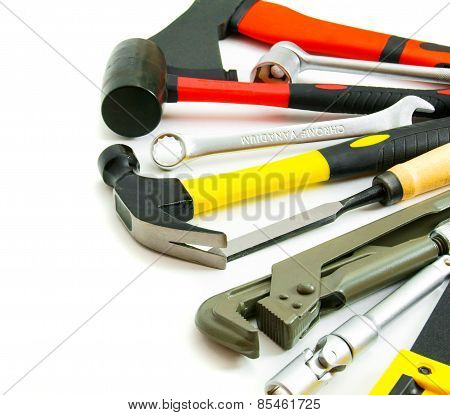Many working tools - saw, axe, pliers and others on white background.