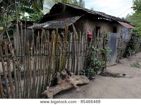 Rural Home In Honduras With Stick Fence