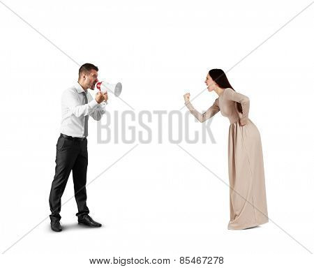 emotional woman showing her fist to screaming man with megaphone. isolated on white background