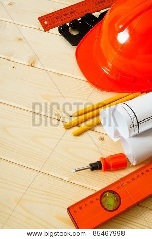 Repair work. Drawings for building, pencils, screw-driver and others tools on wooden background.
