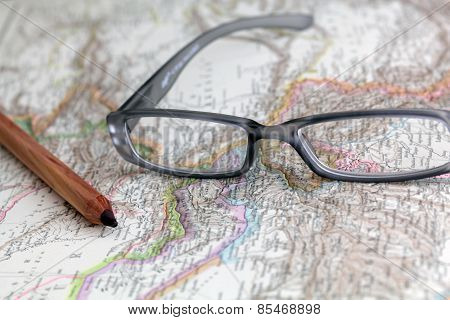 Glasses on a historical map