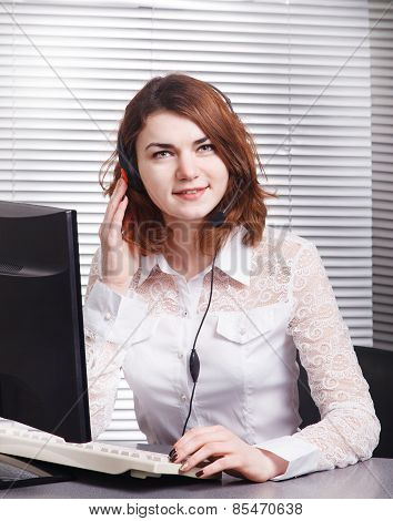 Portrait Of Happy Smiling Cheerful Young Support Phone Operator In Headset