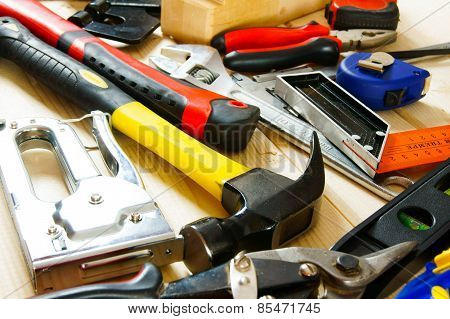 Many working tools on a wooden background.