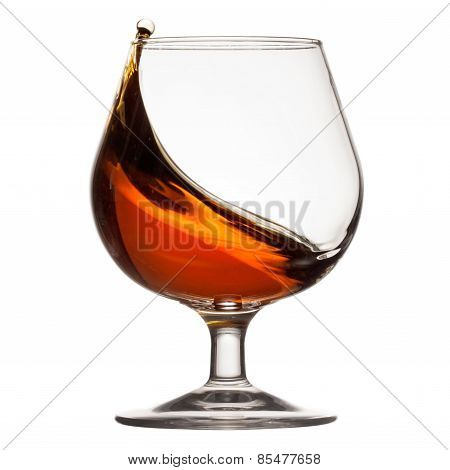 Splash of cognac in glass