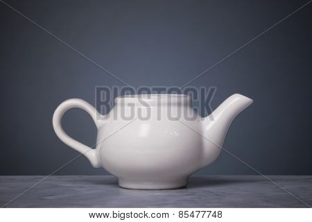 Coffeepot In Front Of Graduated Background