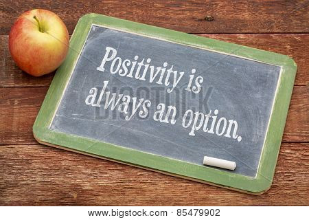Positivity is always an option - text \ on a slate blackboard against red barn wood