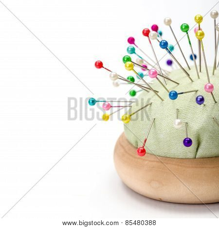 Pincushion Full With Colorful Pins