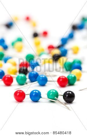 Colorful Push Pins On White