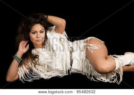 Native American Woman In White Outfit Lay On Black Hand In Hair
