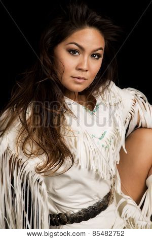 Native American Woman In White Outfit Sit On Black Close Looking