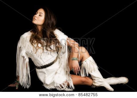 Native American Woman In White Outfit Sit On Black Head To Side