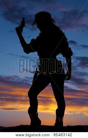 Silhouette Of Cowgirl Holding Up Gun Side Look Down