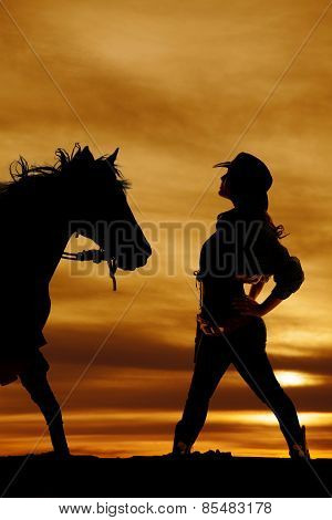 Silhouette Of Cowgirl Side Hands On Hips