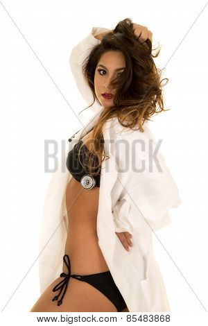 Woman doctor in her lab coat and bikini