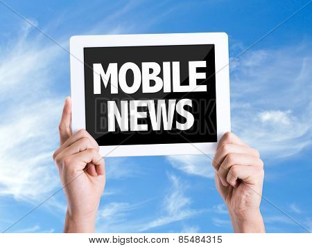 Tablet pc with text Mobile News with sky background