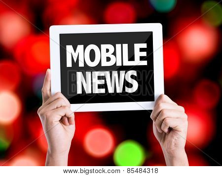 Tablet pc with text Mobile News with bokeh background
