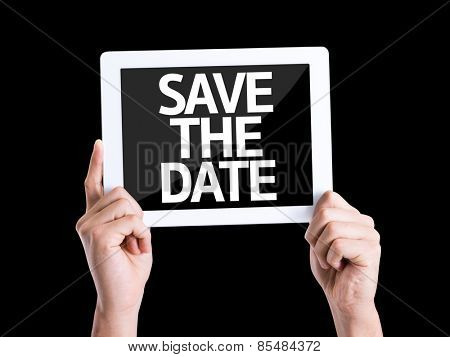 Tablet pc with text Save the Date isolated on black background