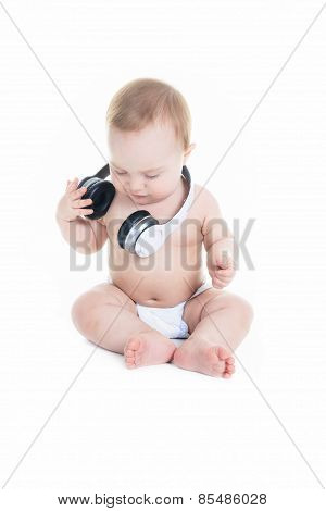 young baby is sitting on a white isolated background listening