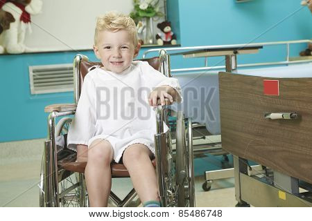 adorable little boy in the wheelchair at the hospital