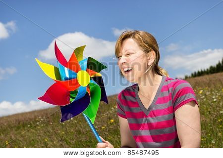 Young Woman With A Windmill