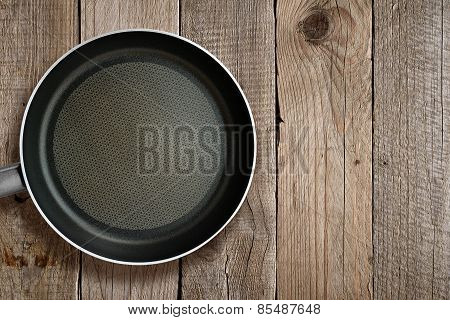Frying Pan On Wooden Background