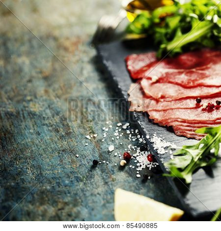 Beef Carpaccio on dark background