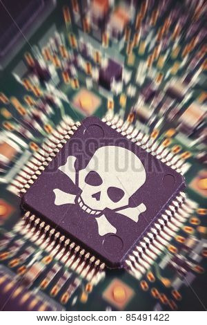 Macro shot of a circuit board with big microchip carrying a pirate symbol