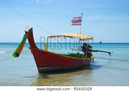 Long-tailed Thai Boat Near The Shore