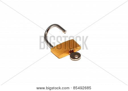 Opened padlock and key to success