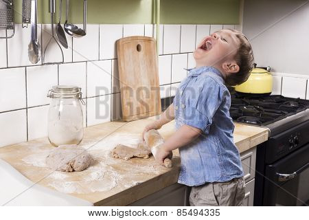 Little Boy In The Kitchen