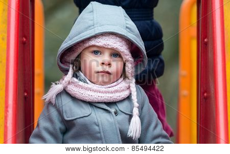Cute Little Girl With Big Blue Eyes Looking At Camera - Very Shallow Depth Of Field