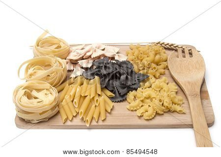 Black And Golden Macaroni, Pastes  On A Wooden Board