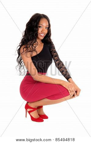 Black Woman Crouching On Floor.