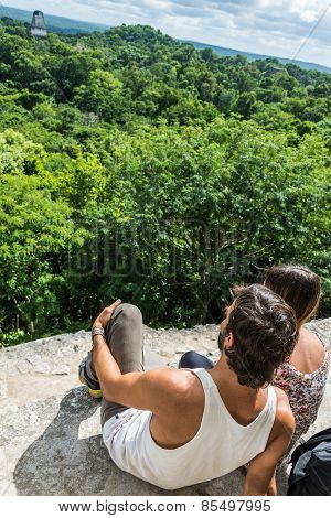 Tourist Taking Photos And Enjoying The View Of Rainforest And Mayan Ruins . Tikal National Park Trav