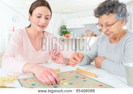 Elderly woman playing a board game