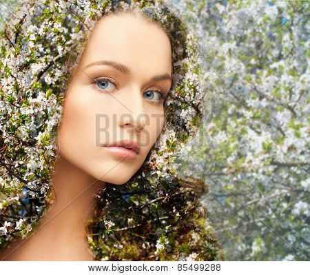 beauty, people, spring, summer season and health concept - young woman over blooming tree floral pattern and double exposure effect
