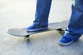 image of skateboarding  - closup of young skateboarder skateboarding legs at skatepark - JPG