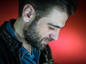 stock photo of fine art portrait  - Portrait of a handsome young man with beard - JPG