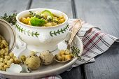 pic of brussels sprouts  - Homemade soup with brussels sprouts and croutons in white bowl decorated with a sprig of thyme - JPG