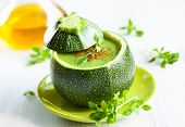 stock photo of zucchini  - Zucchini cream soup served in a round zucchini - JPG