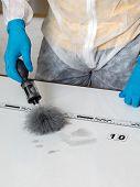 stock photo of criminology  - Disclosure of forensic evidence using fingerprint powders - JPG
