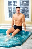 picture of tub  - Young man relaxing in hot tub - JPG