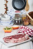image of porterhouse steak  - Raw steaks on the kitchen table ready to cook - JPG