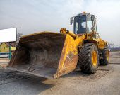 picture of wheel loader  - Front loader on the road repair works - JPG