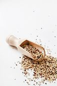 stock photo of quinoa  - quinoa seed grain in a wooden bowl scoop  - JPG