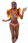 stock photo of samba  - Cheerful beautiful woman samba dancer over white - JPG